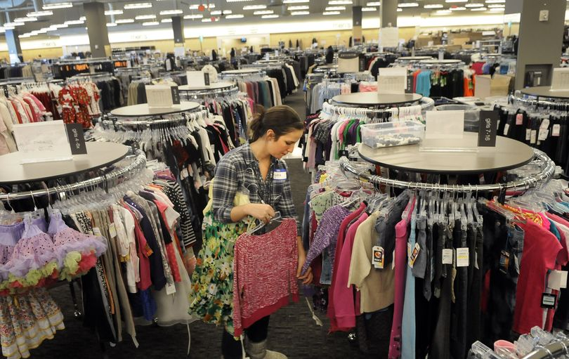 Nordstrom Rack employee Genna Sciamanda, of Cheney, checks the tags for sizes in the children's section of the new Rack store at the Spokane Valley Mall. The Rack is moving from NorthTown Mall to the Valley location and will be open on Thursday.  (Dan Pelle)