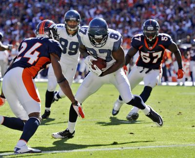 Seattle's Ben Obomanu heads for the endzone on a 12-yard touchdown in the second half as Denver's Champ Bailey (24) defends. (Associated Press)