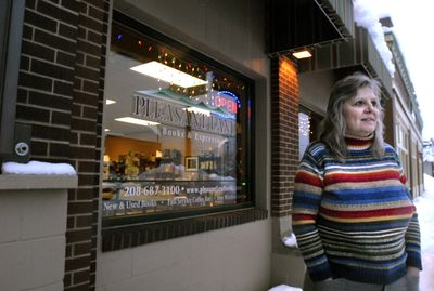 Jan Conner stands in front of her store in Rathdrum Jan. 6, where she believes the foot traffic at Pleasant Land Books and Espresso has been down because her customers have had a hard time getting out of their homes during recent snow storms.  (Jesse Tinsley / The Spokesman-Review)