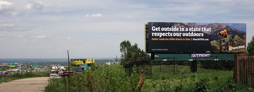 A billboard posted outside Denver, Colorado, encourages hikers, bikers, climbers, paddlers and other recreationists to spend their money outside Utah to protest a movement in the state for transferring federal public lands to local control. (Center for Western Priorities)