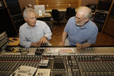 John Giaier, left, and Bill Gildenstern work at a sound mixing board during an interview at Studio A in Dearborn Heights, Mich., June 25. They  created the Rosary Tapes. (Associated Press / The Spokesman-Review)