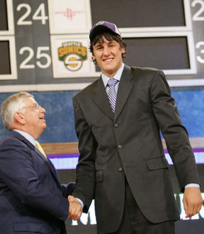 Australian Andrew Bogut, a center from the University of Utah, is congratulated by NBA commissioner David Stern after being picked first in the draft.    (Associated Press / The Spokesman-Review)