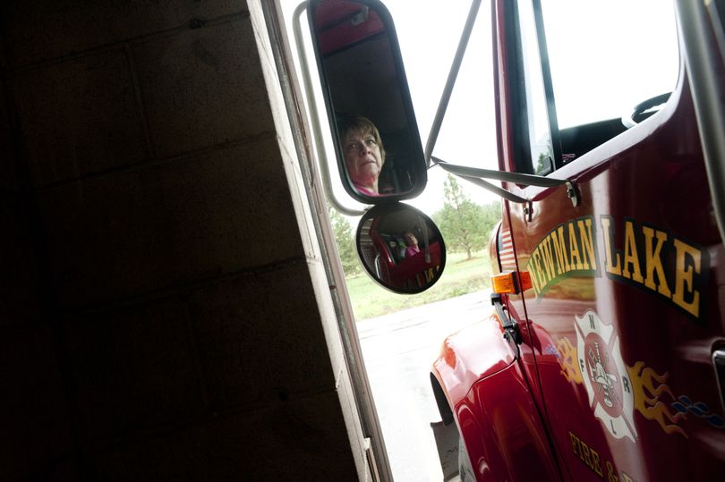 Toni Halloran, Deputy Chief of Newman Lake Fire and Rescue, concentrates as she maneuvers a water tender into the cramped confines of Station 1 on Tuesday. Newman Lake Fire and Rescue is again preparing to ask voters to pass a bond to replace Station 1. (Tyler Tjomsland)