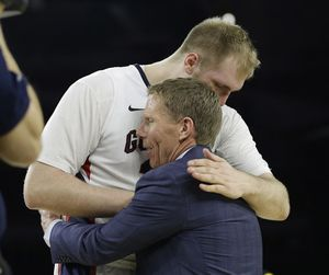 Gonzaga head coach Mark Few hugs Przemek Karnowski after a college basketball regional semifinal game against UCLA in the NCAA Tournament Friday, March 27, 2015, in Houston. Gonzaga won 74-62. (David Phillip / Associated Press)