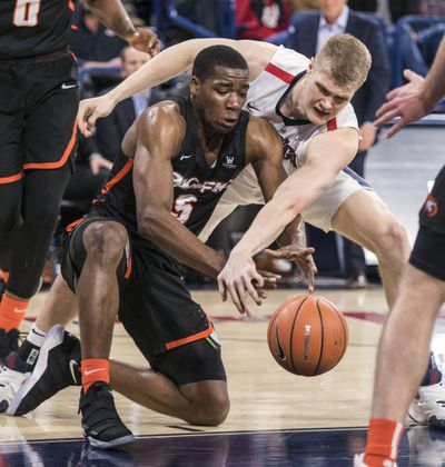Gonzaga center Jacob Larsen slaps the ball away from Pacific forward Anthony Townes, Thursday, Dec. 28, 2017, in the McCarthey Athletic Center. (Dan Pelle / The Spokesman-Review)