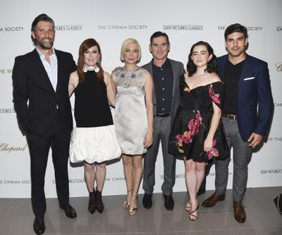 "Director Bart Freundlich, Julianne Moore, Michelle Williams, Billy Crudup, Abby Quinn and Alex Esola attend a screening of their new film ""After the Wedding"" at Regal Essex on Aug. 6 in New York. (Evan Agostini / Invision/AP)"