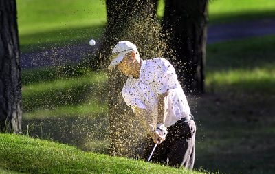 Bob Scott, the MeadowWood Golf Course professional, blasts out of a trap on the 11th hole at Indian Canyon during the Rosauers Open last July. (Christopher Anderson / The Spokesman-Review)