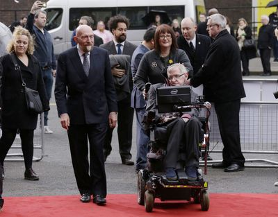 Professor Stephen Hawking, front right, and Professor Kip Thorne, left, arrive for the Interstellar Live show March 30, 2015 at the Royal Albert Hall in London. (Joel Ryan / Joel Ryan/Invision/AP)