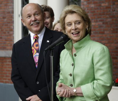 Washington Gov. Chris Gregoire and husband Mike Gregoire stand in front of the Governor's Mansion Monday after the governor announced she won't seek a third term. (Associated Press)
