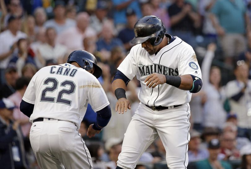 Seattle Mariners' Nelson Cruz, right, celebrates his two-run home run with Robinson Cano, during the fifth inning of a baseball game against the Pittsburgh Pirates on Tuesday in Seattle. (Elaine Thompson / Associated Press)