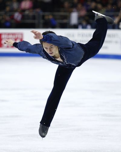 Men's gold medalist Canada's Patrick Chan performs his free skate.  (Associated Press / The Spokesman-Review)