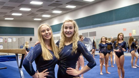 Central Valley High School gymnasts Victoria Axtell, left and Rebekah Ross pose for a photograph before practice on Monday, Jan. 27, 2020. (Kathy Plonka / The Spokesman-Review)