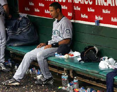 Seattle's Wilson Valdez sits alone in the dugout after his team's 6-5 loss to Oakland in extra innings on Saturday.   (Associated Press / The Spokesman-Review)