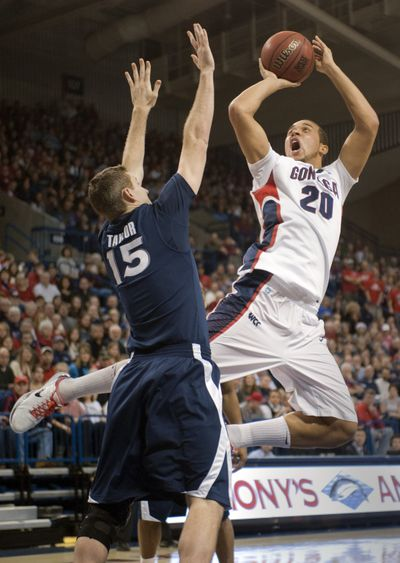 Gonzaga forward Elias Harris shoots over  Andrew Taylor in the first half of Wednesday night's 64-54 home win over the Xavier Musketeers.  (Colin Mulvany)