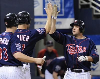 Associated Press Minnesota's Michael Cuddyer hit for the cycle Friday, the second Twins player to do so this season. (Associated Press / The Spokesman-Review)