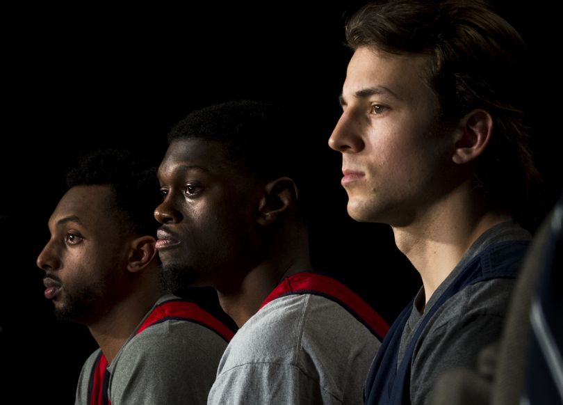 Left to right, Gonzaga guards Byron Wesley (22), Gary Bell Jr. (5), and  Kevin Pangos (4) speak to the media before practice for an NCAA college basketball tournament second-round game in Seattle, Thursday, March 19, 2015. Gonzaga will face North Dakota State on Friday. (The Spokesman-Review)