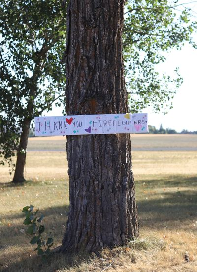 A thank you sign for firefighters working on the Idler Fire near Moscow, Idaho, hangs on a tree.  (Courtesy of the Idaho Department of Lands)