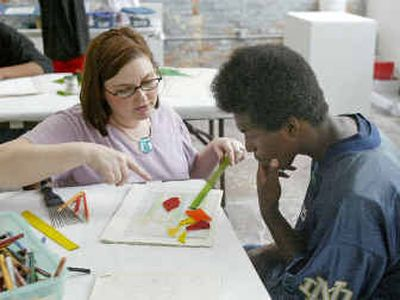 Jaquese Moultrie, 17, right, works with artist-in-residence Devanie Schilpp on a stained-glass project at an after school art program  in Atlanta.   (Associated Press / The Spokesman-Review)