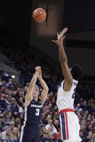 Utah State guard Sam Merrill (3) shoots against Gonzaga forward Rui Hachimura during the first half of an NCAA college basketball game in Spokane, Wash., Saturday, Nov. 18, 2017. (Young Kwak / Associated Press)