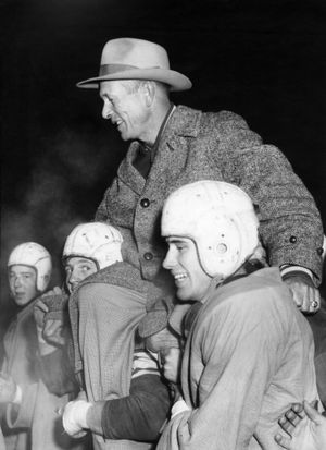 Gonzaga Prep football coach Billy Frazier is carried off the field by his players in 1952. (The Spokesman-Review archives)