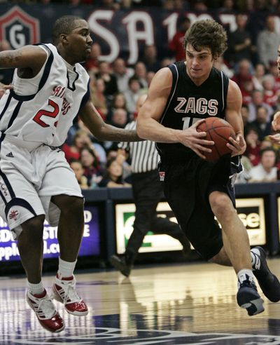 Gonzaga guard Matt Bouldin drives to the basket in front of Saint Mary's guard Wayne Hunter in first-half action.   (Associated Press / The Spokesman-Review)