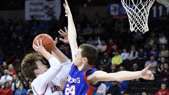 Liberty post Van Ricker (40) takes a shot as Willapa Valley center Beau Buchanan (24) defends during a WIAA State 2b Hardwood Classic basketball game, Thurs., March 5, 2020, in the Spokane Arena. (Colin Mulvany / The Spokesman-Review)