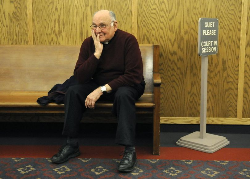 The Rev. Joseph Weitensteiner waits in the fourth-floor hallway of the Spokane County Courthouse to testify in the Morning Star Boys' Ranch trial on Wednesday. 
