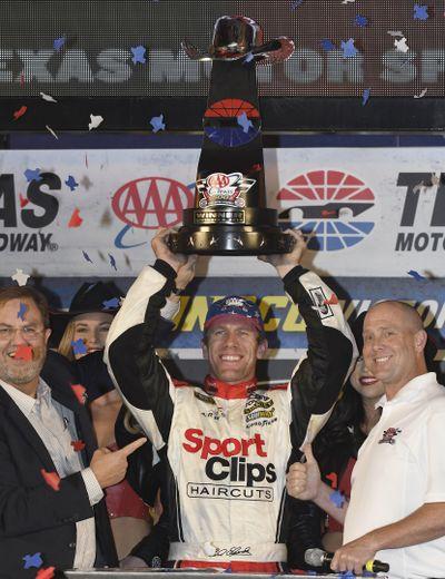 Carl Edwards, center, celebrates in victory lane after winning at Texas Motor Speedway. (Larry Papke / AP)