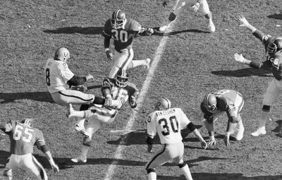 Associated Press Raiders punter Ray Guy (8) is hit by Denver's John Schultz during the AFC championship game Jan. 1, 1978. (File Associated Press / The Spokesman-Review)