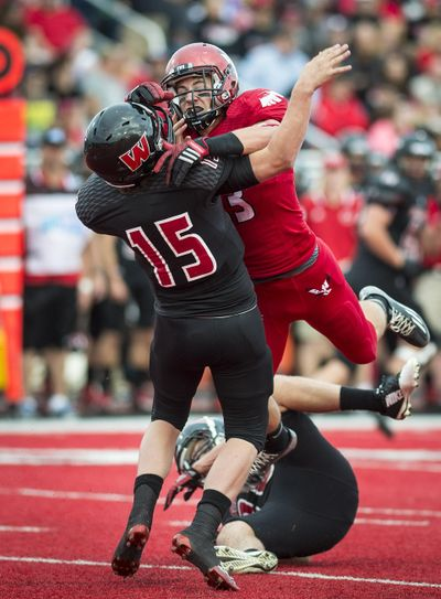 Eastern defensive lineman Marcus Saugen levels Montana Western quarterback Tyler Hulse in a 2014 game on Roos Field in Cheney. Saugen, who played high school football at North Central, says the defense needs to regain its toughness. (Colin Mulvany / The Spokesman-Review)