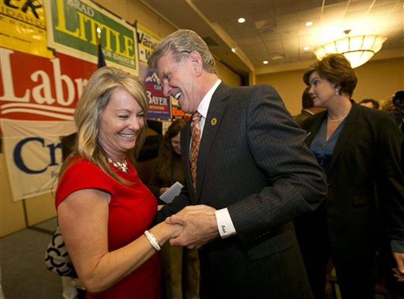 Sherri Ybarra, candidate for superintendent of education, is greeted by Gov. Butch Otter at the Republican election night party, Tuesday Nov. 4, 2014, at the Riverside Hotel in Boise, Idaho. (AP/Idaho Statesman / Darin Oswald)