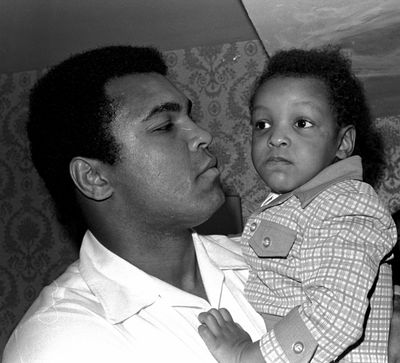FILE - In this April 15, 1975 file photo, Heavyweight boxing champion Muhammad Ali, and Little Muhammad Ali, his 2 1/2 year old son, arrive at Miami Beach, Fla. Muhammad Ali's son, who bears the boxing great's name, was detained by immigration officials at a Florida airport and questioned about his ancestry and religion in what amounted to unconstitutional profiling, a family friend said Saturday, Feb. 25, 2017. (ASSOCIATED PRESS)
