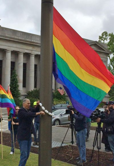 "OLYMPIA – Gov. Jay Inslee helped raise the Rainbow flag over the Capitol Campus Friday and said the state succeeds, in part, because it is accepting. companies large and small are willing to come to Washington because it doesn't care about race, religion or ""who a person loves."" (Jim Camden / The Spokesman-Review)"