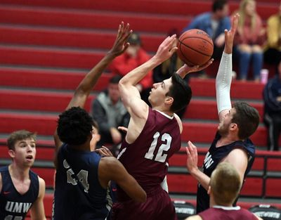 Whitworth's Sam Lees looks to score between Mary Washington's Trey Barber, left, and Drew Johnson during first-half action on Monday night. (Colin Mulvany / The Spokesman-Review)