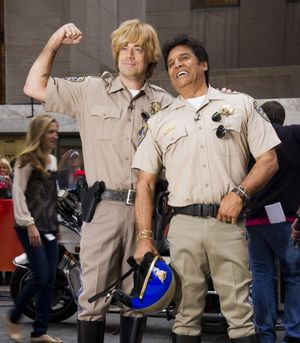 "In this Oct. 31, 2013, AP file photo, former ""CHiPs"" star Erik Estrada, right, poses with Carson Daly on NBC's ""Today"" Halloween show in New York. (AP/Invision file photo by Charles Sykes)"