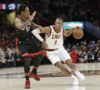 In this April 3, 2018, file photo, Cleveland Cavaliers forward Rodney Hood (1) drives past Toronto Raptors' DeMar DeRozan (10) during the first half of an NBA basketball game in Cleveland. A person familiar with the situation says the Cavaliers will not fine or suspend Hood for refusing to enter Game 4 against Toronto. (Tony Dejak / Associated Press)