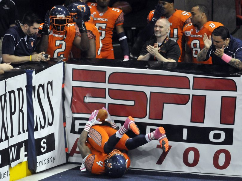 The Spokane Shock's Duane Brooks hauls in a touchdown pass and tumbles into the endzone corner in the first half Friday, May 11, at the Spokane Arena. (Jesse Tinsley / The Spokesman-Review)