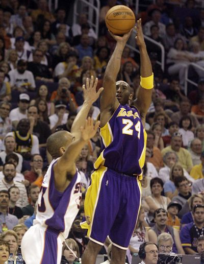 A 49-point performance by Lakers guard Kobe Bryant, shooting over Phoenix's Grant Hill in the third quarter, wasn't enough to beat the Suns.  (Associated Press / The Spokesman-Review)