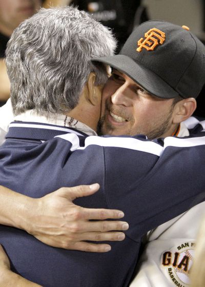 Jonathan Sanchez hugs his father after Friday's no-hitter.  (Associated Press / The Spokesman-Review)