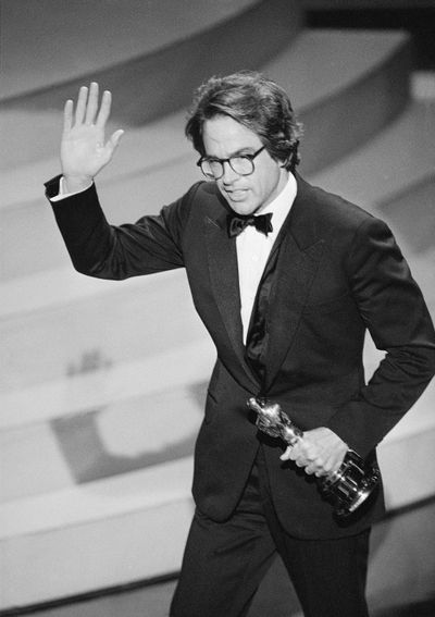 "Warren Beatty waves to the audience as he leaves the stage after accepting the Oscar for directing, for the movie ""Reds,"" at the 1982 Academy Awards in Los Angeles. Beatty played quarterback Joe Pendleton in the 1978 Academy Award nominated movie ""Heaven Can Wait."" (Anonymous / Associated Press)"