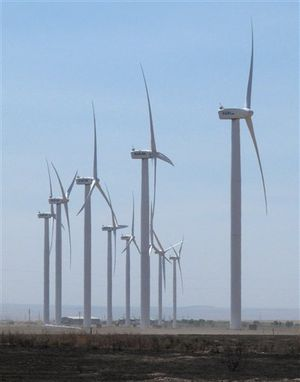 Wind turbines owned by Chicago-based Exelon Corp. turn on Thursday, Aug. 2, 2012 near Mountain Home, Idaho. Idaho is in the midst of a fight between utilities and wind developers. (AP / John Miller)