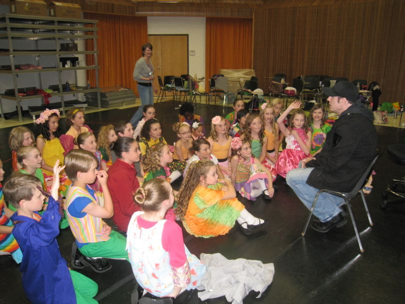John Travolta, speaking to the cast of Munchkins in the Coeur d'Alene Summer Theatre's