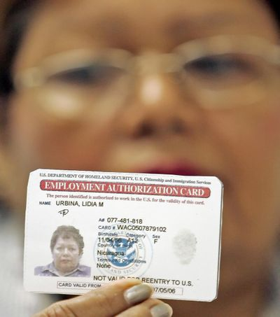 Lidia M. Urbina, of Nicaragua, shows a copy of her work permit Thursday, Jan. 26, 2006, in Miami. (ALAN DIAZ / Associated Press)