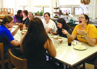 Cyndil Markert, far right, laughs with her Steel House roommates on the University of Idaho campus in Moscow during one of their nightly community dinners. The University of Idaho announced in March that it would be closing Steel House, the nation's oldest on-campus women's cooperative dorm.   (Amanda Smith / The Spokesman-Review)
