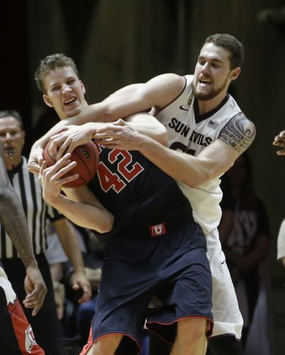 Utah's Jakob Poeltl, left, fights for a loose ball against Arizona State's Eric Jacobsen in the first half. (Associated Press)