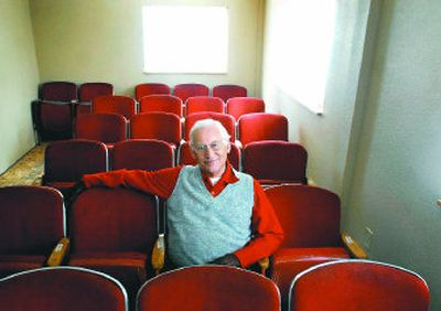 Jim Coulson sits in one of the 29 seats he purchased from the Fox Theater for his home theater.   (Jed Conklin / The Spokesman-Review)