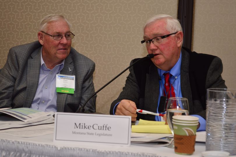 Idaho Sen. Lee Heider, R-Twin Falls, left, listens as Montana Rep. Mike Cuffe, R-Eureka, speaks about invasive mussels at a Pacific Northwest Economic Region conference in Boise. (PNWER)