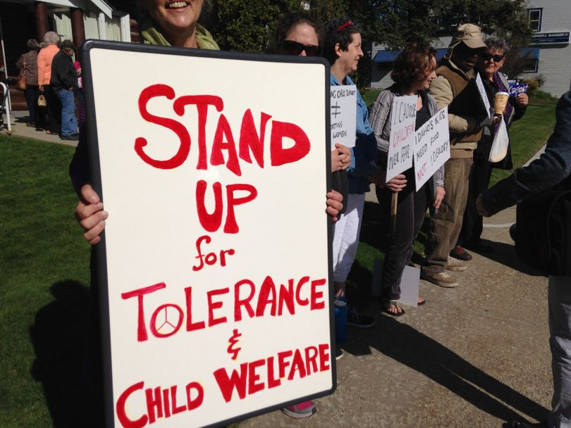 Protesters outside a well-attended talk in Sandpoint on Tuesday morning by anti-Islam speaker Shahram Hadian (Scott Maben)