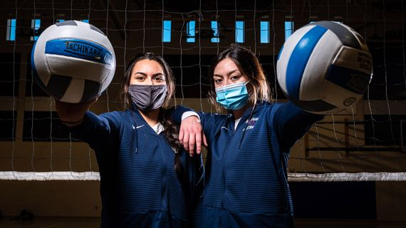 Mt. Spokane's Allen sisters, junior Teila, left, and senior Tia, pose for a portrait before their Greater Spokane League 4A/3A volleyball sweep against Cheney on Tuesday.  (COLIN MULVANY)