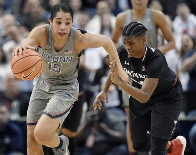 Connecticut's Gabby Williams, left, is pursued by Cincinnati's Maya Benham, right, during the second half of an NCAA college basketball game, Sunday, Feb. 4, 2018, in Hartford, Conn. (Jessica Hill / Associated Press)